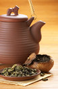 Tea and teapot green pu erh aged in mandarin ceramic Stock Images