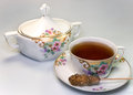 Tea time antique crockery with and sugar stick Stock Photo