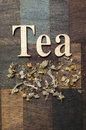 Tea time concept words and dry mountain leaves on wooden background Royalty Free Stock Images