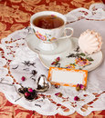 Tea time with dessert rose party marshmallows brewing rosebuds Royalty Free Stock Images