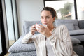 Tea time at home peaceful woman relaxing with cup of Stock Photography