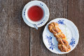 Tea time outside with cup of and fresh pastry Royalty Free Stock Photography