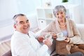 Tea time portrait of mature men and his wife drinking at home Royalty Free Stock Photography