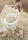 Tea time sugar candy empty glass with Stock Image