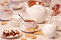 Tea time with sweet cookies and nuts Stock Photo