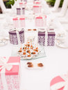 Tea time table setup with finger food and presents Stock Photography
