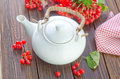 Tea and viburnum on a table Royalty Free Stock Images