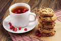Tea with wild strawberries and cookies cup of chocolate on table Stock Image