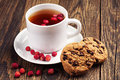 Tea with wild strawberries and cookies cup of sweet chocolate Stock Images
