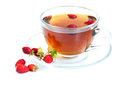Tea and wild strawberries cup of on a white background Stock Photo