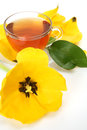 Tea and yellow tulip Royalty Free Stock Image