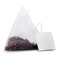 Teabag with label isolated on a white clipping path Royalty Free Stock Photos