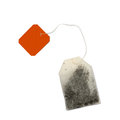 Teabag with red label top view isolated on a white background Stock Image