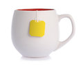 Teabag white ceramic mug with label isolated on a white Royalty Free Stock Photography