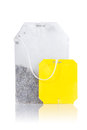 Teabag with yellow label Royalty Free Stock Images
