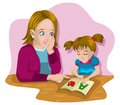 Teach a mother who was teaching his daughter to read the letter alphabet Stock Photo