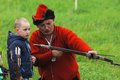 Teacher archery and kid russia molodi village july unidentified man in retro costume teach on event dedicated to victory in battle Stock Photos