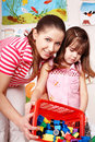Teacher and child with construction set lego. Royalty Free Stock Photo