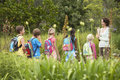 Teacher with children on field trip young nature Royalty Free Stock Photos