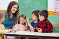 Teacher with children playing musical instruments happy in classroom Royalty Free Stock Photo