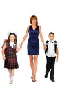 Teacher and children young women in full length studio isolated Royalty Free Stock Photography