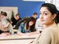 Teacher in classroom Royalty Free Stock Photo