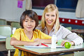 Teacher coaching japanese student in elementary school Stock Image