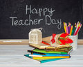 Teacher day flowers and gift copybooks on the teacher s desk Royalty Free Stock Image