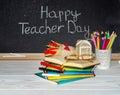 Teacher day flowers and gift copybooks on the teacher s desk Stock Photo