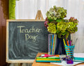 Teacher day hydrangea flowers and copybooks on the teacher s d desk glasses board pencils Royalty Free Stock Photography