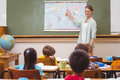 Teacher giving a geography lesson in classroom at the elementary school Stock Images