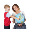 Teacher helping elementary student portrait of pretty tutor and her pupil with a globe over white background Royalty Free Stock Images
