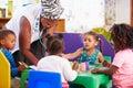 Teacher helping kids in a preschool class Royalty Free Stock Photo