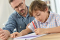 Teacher helping schoolboy with lesson Royalty Free Stock Photo