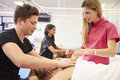 Teacher Helping Student Training To Become Masseuse Royalty Free Stock Photo