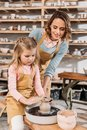teacher and kid making ceramic pot Royalty Free Stock Photo