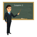 Teacher on lesson in classroom. Young teacher with pointer showi