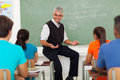 Teacher lesson students friendly male explaining to in classroom Stock Photography
