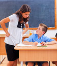 Teacher looking at pupil's homework Stock Photos