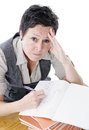 Teacher marking students work frustrated Royalty Free Stock Photo