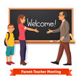 Teacher and parent meeting in classroom Royalty Free Stock Photo