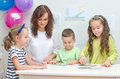 Teacher plays with children in kindergarten Stock Photo