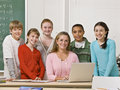 Teacher posing with students Stock Image