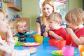 Teacher With Pre School Children Eating Healthy Snacks At Breakt Royalty Free Stock Photo