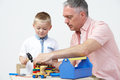 Teacher And Pre School Pupil Playing With Wooden Tools Royalty Free Stock Photo