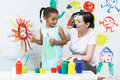Teacher and pupil in pre school art class painting Royalty Free Stock Images
