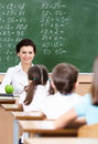 Teacher questions pupils Royalty Free Stock Photos