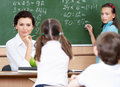 Teacher questions pupils at mathematics Stock Photos