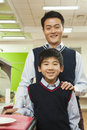 Teacher and school boy portrait in school cafeteria Stock Photography