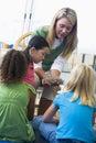 Teacher showing bird's nest to children Royalty Free Stock Image